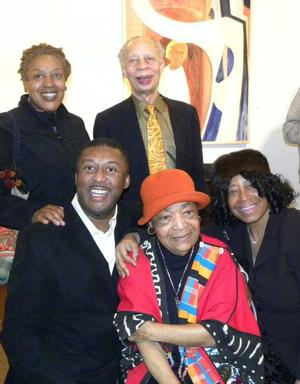 At the opening reception for   Samella Lewis and the African American Experience, Louis Stern Fine Arts, Los Angeles, February 25, 2012:  Samella Lewis (center) with friends.  Front row: Dianne Whitfield-Locke and Clark Baker.  Back: CHH Pounder, Richard A. Long.  Photo: collection of Clark Baker.