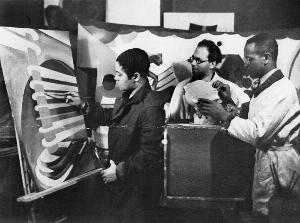 Viktor Lowenfeld (center) looking over the work of two of the first Hampton students to receive art fellowships, Michael Portilla (left) and Joseph Gilliard (right), 1941.  Hampton University Museum and Archives.