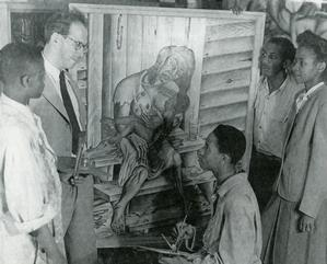 John Biggers, seated, with Mother and Child painting on easel, 1944. Art Instructor Viktor Lowenfeld (second from left) encouraged the students to express their frustration with poverty and other conditions of opression in the South.  (Standing far right are Frank Steward and Ada Ferguson Vann.) Photo: Hampton University Archives