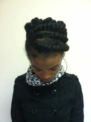 IRAAA intern Marlisa Sanders wearing a twisted sculptural up-do that she created