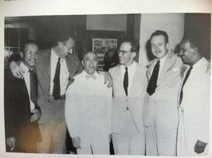 "Hampton Institute Press Service release, 1943: ""Above are shown some of the white and Negro representatives of the contemporary art world who were present at the unveiling of Charles W. White's mural at Hampton Institute last Friday, and who participated in panel discussion on ""Art and Democracy.""  Left to Right they are, White, the 25 year-old muralist, who is a native of Chicago, Harry Sternberg, noted painter, of the New York Art Students League, James V. Herring, chairman of the art department at Howard University, Dr. Viktor Lowenfeld, noted Viennese psychologist and artist,, who heads the Art Center at Hampton, Hans Van Werren-Griek of the Virginia Museum of Fine Art, and Hale Woodruff, well-known painter, of Atlanta University."" Photo: Ed Jones; courtesy Hampton University Archives"
