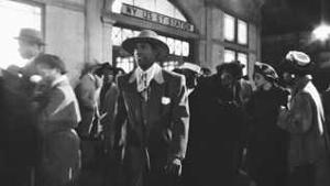 Malcolm Little/Malcolm X (Denzel Washington) on 125th Street in Malcolm X (Warner Bros. and 40 Acres and a Mule Filmworks, 1992).