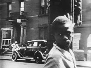 Donald (Donald Thompson) on the streets of Harlem in The Quiet One (Film Documents, 1948).
