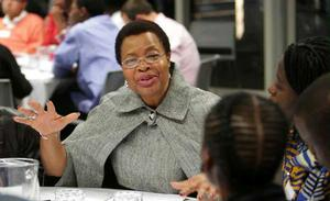 Graca Machel, Nelson Mandela's wife, 2010, Johannesburg. The hair of the girl in the foreground is a masterful example of design and execution in sculptural creation. However, in the U.S., survivals of this style were disparaged as black people sought full opportunites and acceptance American citizens in the 20th century.  Having short hair was a shameful stigma for African American girls growing up during much of the 20th century.  Photo: The Elders