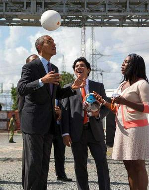 Young woman demonstating soccket ball to Obama during Tanzanian trip.