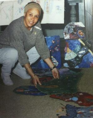Betye Saar installing works at NCA Gallery for her solo show, 1987. Photo: Edsel Reid