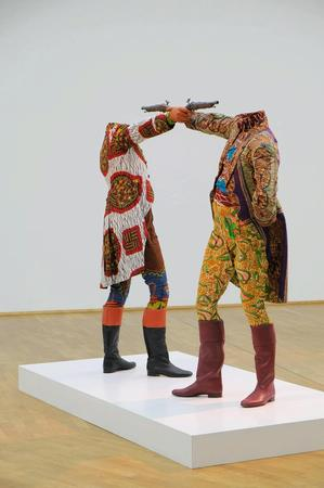 Yinka Shonibare, How To Blow Up Two Heads At Once (Gentlemen), 2006. Installation view MMK Museum für Moderne Kunst Frankfurt am Main. Photo: Axel Schneider © MMK Frankfurt