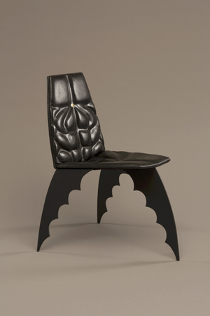 Global Africa Project: Alex Locadia, The Batman Chair, 1989, leather, steel, wood, paint, laminated tin pin. Museum of Arts and Design; gift of Jenette Kahn, 1992. Photo: Ed Watkin