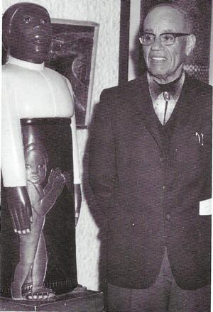 Sargent Johnson with his Forever Free sculpture, 1967.  Samella Lewis Archive, Hampton University Museum
