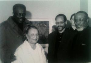 EJ Montgomery with artist Sam Gilliam; Allan Edmunds, director of Brandywine Workshop; and Norman Parish of Parish Gallery-Georgetown, Washington, DC, at the opening of the 1999 EJ Montgomery exhibit at the Parish Gallery. Photo: EJ Montgomery collection