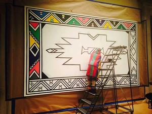 Esther Mahlangu working on second mural. Photo: Richard Woodward