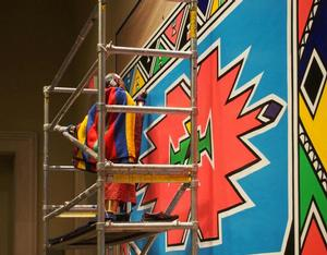 Esther Mahlangu working on first mural. Photo: Richard Woodward