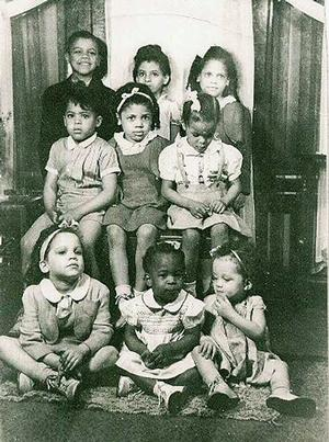 Sue Irons, center, bottom row, with cousins. Photo: Senga Nengudi collection