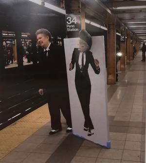 Margaret Vendyres toting Punu Janelle in New York City subway