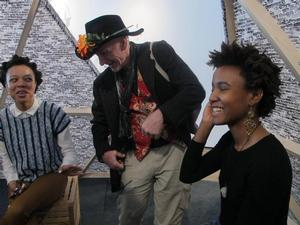 Clothing Designer, Zunyda (right) with artist Stephen McKenzie and gallery visitor during live broadcast