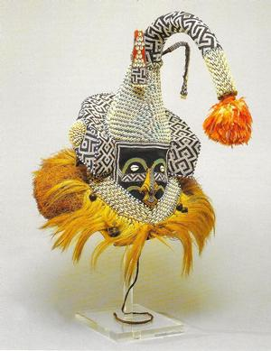 Mask, Mukenga, raffia, hide, trade cloth, beads, wood, cowrie shelles, parrot feathers, animal hair, brass. Collection Hampton University Museum
