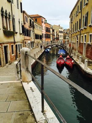 Canal with red boats. Photo: Michelle-Renee Perkins