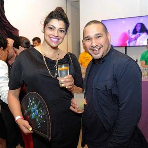 Curator Jamine Wahi and artist David Antonio Cruz at auction enjoying cocktails by a program sponsor, Ketel One. Photo: Africa's Out! Facebook page