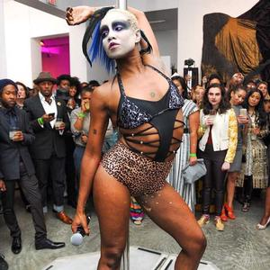 Ayo Janeen Jackson AKA Miss Appropriation performs at auction event. Her look is inspired by the fantastical figures in Mutu's collages. Photo: Africa's Out! Facebook page