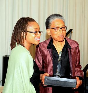 Award presenter Melanee Harvey, Howard University lecturer and colloquium program co-coordinator (left) and 2015 award recipient Juliette Harris, IRAAA.  Photo: John Body