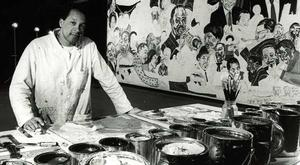 "Figure 5.  Frederick J. Brown at his worktable during the painting of The Assumption of Mary at Xavier University in 1992. Detail of the painting behind him shows ""The Choir"" (featuring many of his favorite musicians) in progress. Photo: Cheryl Gerber Brown."