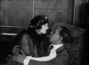 Eve Mason returns to visits Hugh Van Allen in Symbol of the Unconquered (1920)