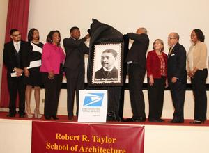 Brian Johnson and William Campbell unveil replica of Taylor stamp, February 2015.  Next to Campbell are Ellen Weiss, Richard Dozier and Daya Irene Taylor. Photo: R. Dozier collection
