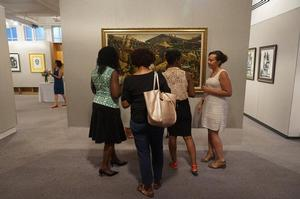 Guests viewing John Bigger painting in Angelou collection. Courtesy Swann Galleries
