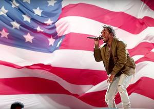 Kendrick Lamar performing in front of William's Pope L's flag from Trinket, 2015 BET Awards show