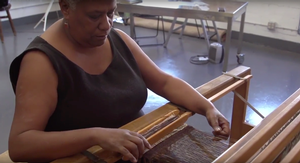 Karen Hampton at her loom. (Wellin Museum video)