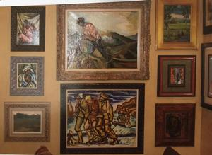 Hallway in Robinson home. The large works in the center are Humbert Howard's Fisherman, 1951 oil and Claude Clark's Three Soliders, 1947 oil (Jerry Langley)