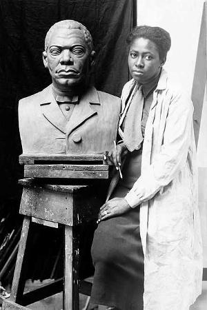 Selma Burke with her portrait bust of Booker T. Washington, c. 1935 WPA, Federal Art Project (Pinchos Horn)