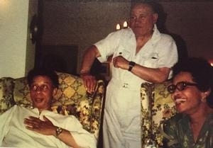 Romare Bearden (center) with Richard A. Long and Jenelsie Holloway in Long's Atlanta home (Susan Ross)
