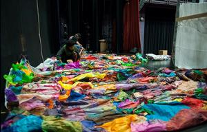 Maya Freelon Asante's tissue paper art colorfully symbolizes laundry in the Clothesline Muse theatrical production