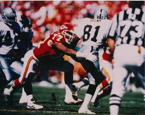 Pellom McDaniels, Kansas City Chiefs, tackling Tim Brown of the Oakland Raiders, 1995. Photo: Harold McCardie