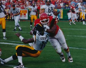 Pellom McDaniels, Kansas City Chiefs, sacking Kordell Stewart of the Pittsburgh Steelers, 1997. Photo: Harold McCardie