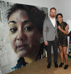 Aron Belka and Rosario Dawson with Alturist painting at Miami Art Basel