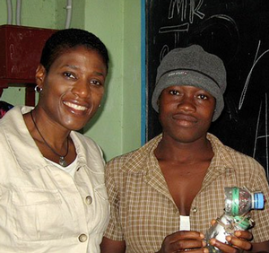 Cassandra Butts with school girl in Liberia, 2010. Photo: MCC