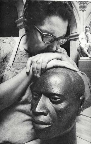 Elizabeth Catlett meditating on her work. Photo: Elizabeth Catlett estate