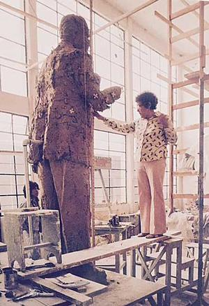 Elizabeth Catlett working on Louis Armstrong statue in her studio. Photo: Elizabeth Catlett estate