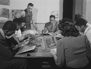 Painting Class at South Side Community Art Center, 1942. Instructor  Eldzier Cortor (standing), Gordon Parks (sitting, facing forward)